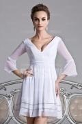Robe blanche à col V plongeant avec manches 3/4 & jupe paillettée